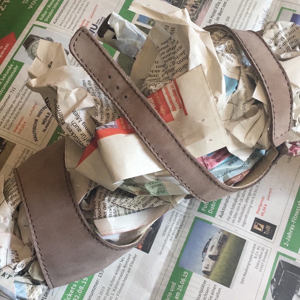 A clog seen from above, stuffed with newspaper to support its shape.